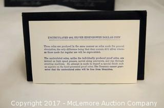 Four Eisenhower Uncirculated Silver Dollars