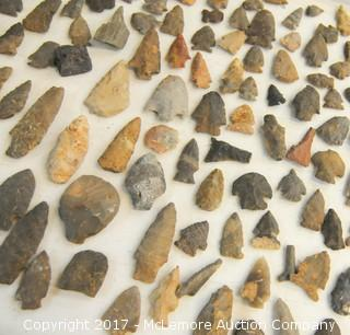 Collection of Arrow Heads with Books