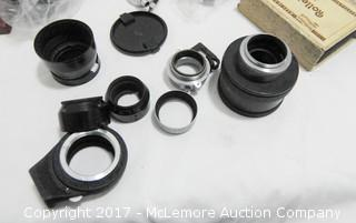 Assortment of Vintage Camera Equipment and Accessories