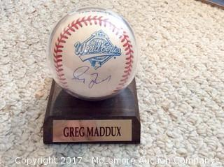 Greg Maddux Autographed 1995 World Series Baseball with Scoreboard COA
