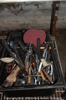 Assortment of Kitchen Utensils and Pot Tops