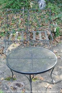 Two Wrought Iron Chairs and a Table