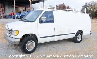 1996 Ford E250 HD Super Econoline with a 5.8L V8 OHV 16V Engine with Roof Rack