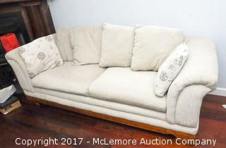 Upholstered Couch with Wooden Feet by Sealy with Pillows