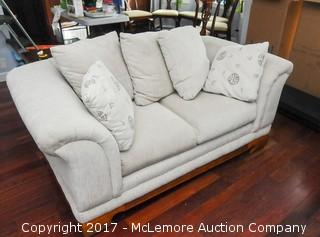 Upholstered Love Seat with Pillows and Wooden Base
