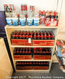 Collection of Coca Cola 8oz Bottles with Commemorative Labels and Glasses