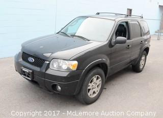 2005 Ford Escape 4WD Limited with a 3.0L V6 DOHC 24V engine.