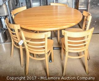 Round Wooden Table With Five Wooden Chairs