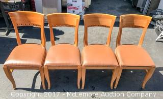 Four Solid Wood Chairs With Vinyl Cushions