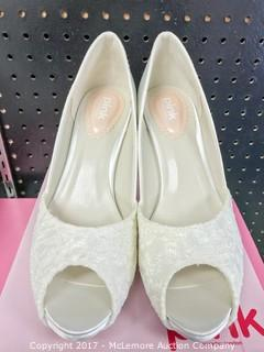 Pair of Pink Ladies Shoes