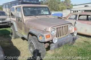 1998 Gold Jeep Wrangler 4.0L 5sp VIN 1J4FY1959XP486996