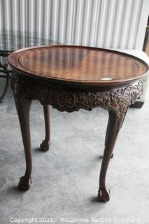 Walnut Occasional Table.  Carved Details and Ball and Claw feet28h x 30w