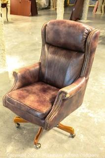 Seven Seas Seating Nailhead Office Chair with Top Grain Leather  Some sun fading on the leather as pictured but this is as comfortable of an office chair as I've ever sat in.  This thing is amazing