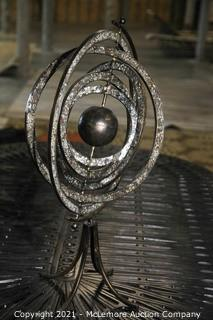 Moving Sculpture with Mosiac Stones on Rings.  Artist not Found