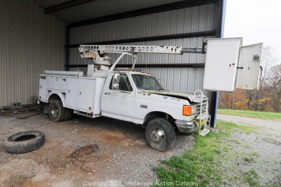john deere 5420 4x4, enclosed cab tractor with loader, farm equipment,  cajun fiberglass fishing boat with johnson 130 outboard, ford bucket truck,  tools,