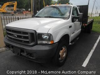 2004 Ford F-450 SD with a 6.0L V8 OHV 32V TURBO DIESEL Engine with Flat Bed