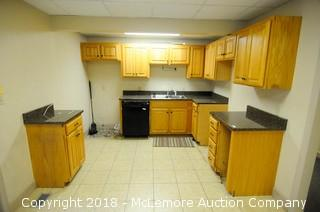 Kitchen Area Cabinets and Granite Countertops with Stainless Sink