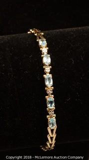 10K Yellow Gold Blue Topaz Bracelet
