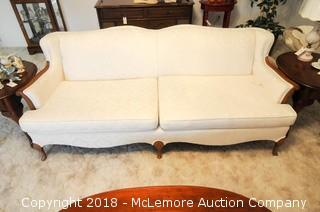Upholstered Couch with Embossed Print Fabric with Exposed Wood Legs and Arms