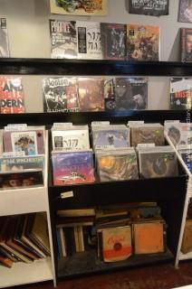 Assortment of Vinyl Records and Display Merchandiser