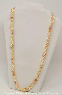 One 30 Inch Long Continuous Triple Strand Rice Shape Freshwater Cultured Pearl Necklace