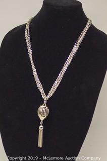 Triple Strand Base Metal Chain With A 25mm Diameter Hollow Sphere Centerpiece With Tassle