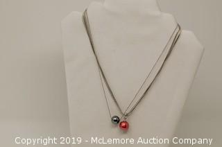 Two Sterling Silver Necklaces: One Has Simulated Black Pearl And The Other Has Five Strands of Dyed Freshwater Cultured Pearls