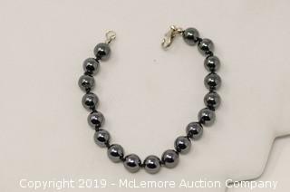 One 7 Inch Long Bracelet with 8mm Diameter Dark Gray Hematite Beads (Broken Clasp)