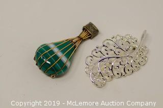 Two Brooches: One A Sterling Silver Balloon with Green Simulated Gemstones and 14K Gold Trim and One Base Metal Feather