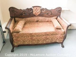 Antique Wooden Upholstered Couch with Ornate Carved Dragons Back and Carved Legs with Unique Pull Out Sleeper